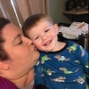 mom kissing young son in pajamas