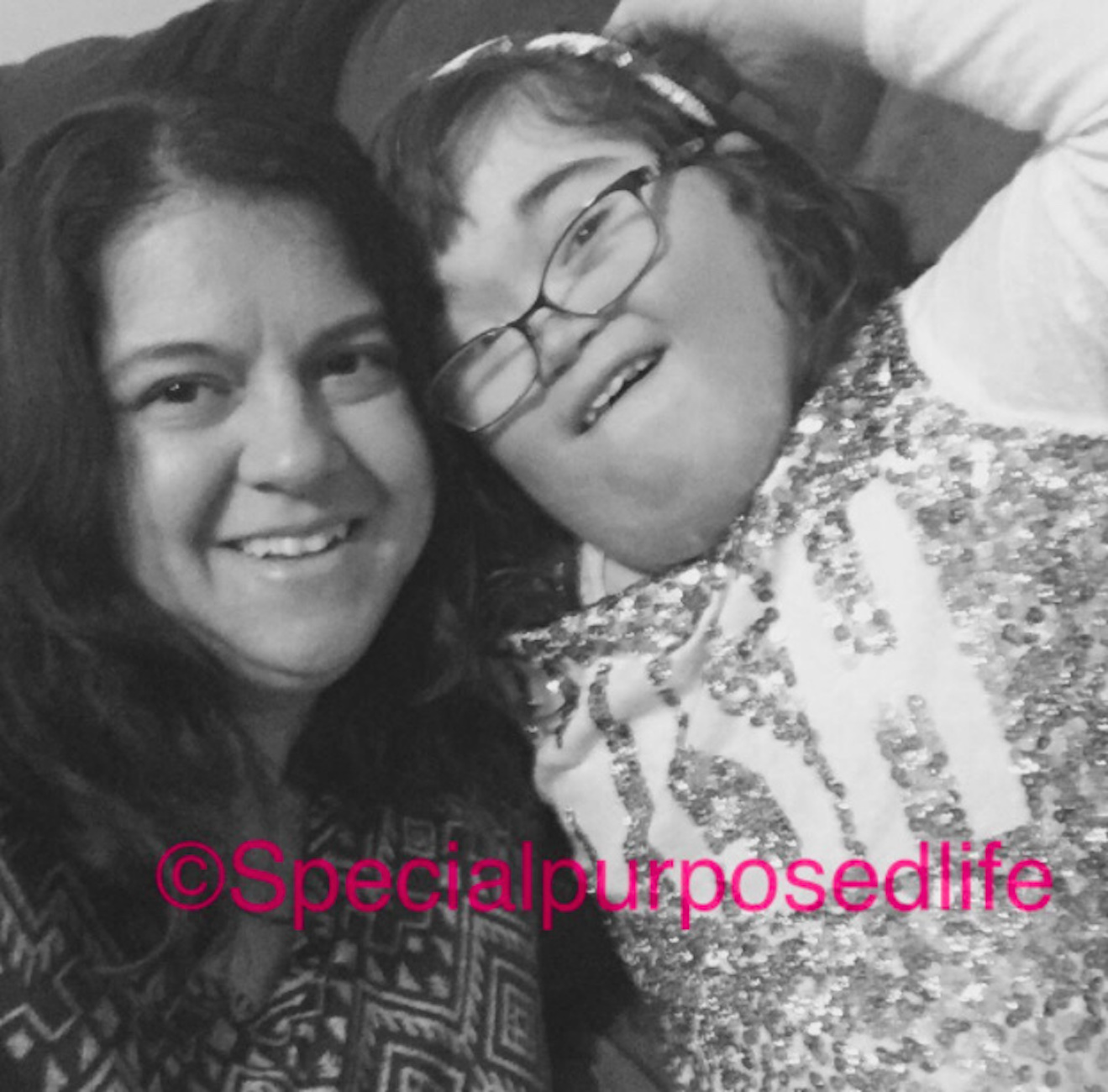 Black and white photo of mom and daughter with [@specialpurposedlife] on the photo