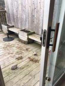 Photo of deck in backyard with dirt on it