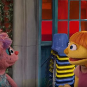 Julia, a new character on Sesame Street, talking with another character