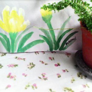 Painting of yellow flowers next to a green plant in a pot