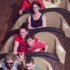 Woman sitting on Splash Mountain Ride with her arms crossed and a scowl on her face.