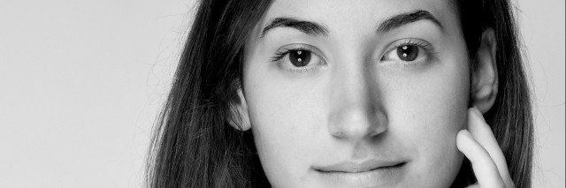 face shot of young woman.