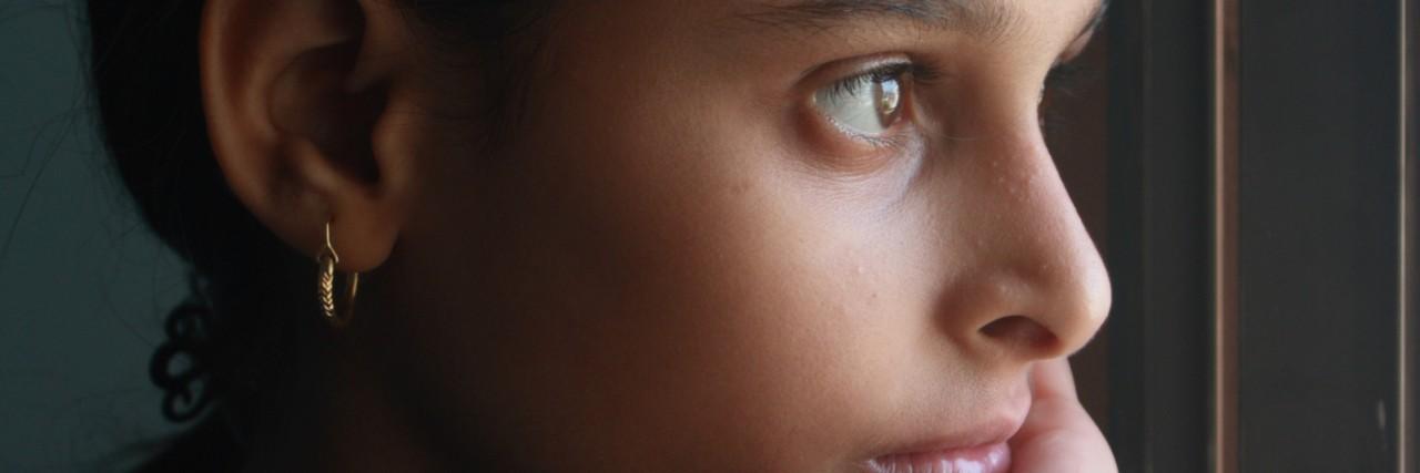 Portrait of teenage girl in window light