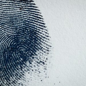 Thumbprint on paper.