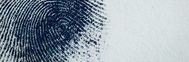 Thumbprint on paper.