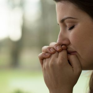 profile view of young woman crying depression