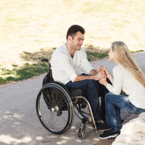 Young man in a wheelchair on a date in the park.