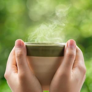 Woman drinking a spot of tea.
