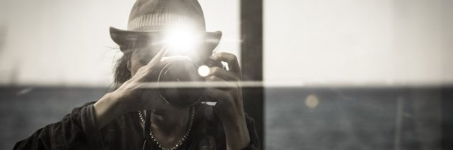 woman taking flash photographs with her camera