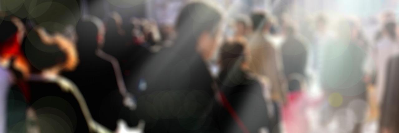 Blurred photo of people walking on city street