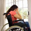 Worried woman in a wheelchair.