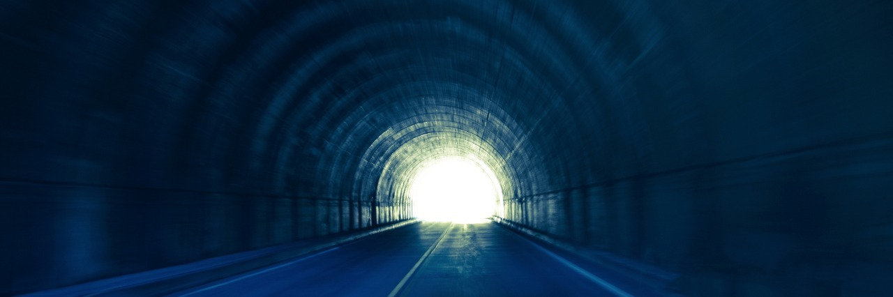 dark tunnel with light at the end