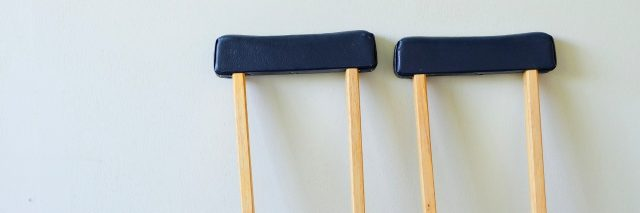 crutches leaning against wall
