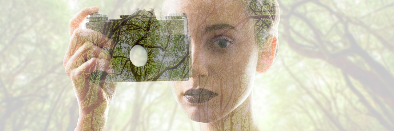 Portrait of young woman with photo camera with double exposure image technic combinated with green forest