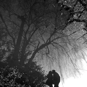 picture of a couple kissing in front of a free