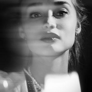 A blurry portrait of a woman