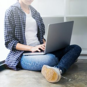 Young woman using computer.