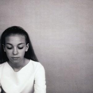 Teenage girl looking down