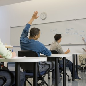 University professor teaching his students in a classroom.