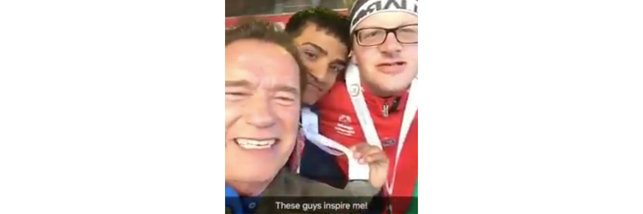 Arnold Schwarzenegger takes a video selfie with Special Olympics athletes.