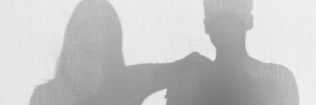Silhouettes of women, one has her arm on shoulder