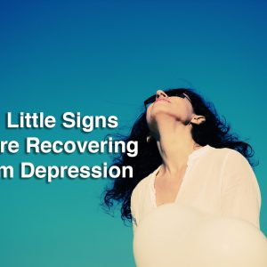 a woman looking up at the sky. Text reads: 26 little signs you're recovering from depression