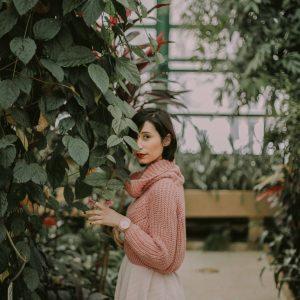 woman behind ivy
