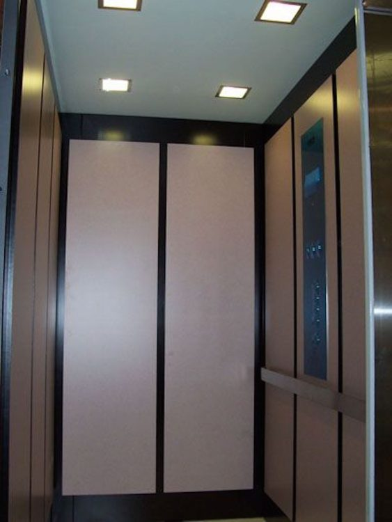 The inside of an elevator.