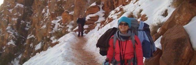 woman in heavy clothing backpacking in grand canyon