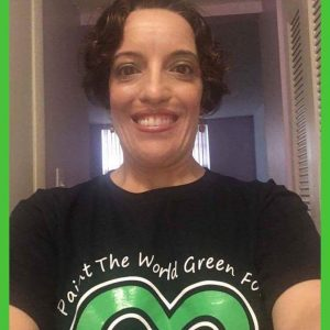 Nicole Luongo wearing her green and black cerebral palsy awareness t-shirt.