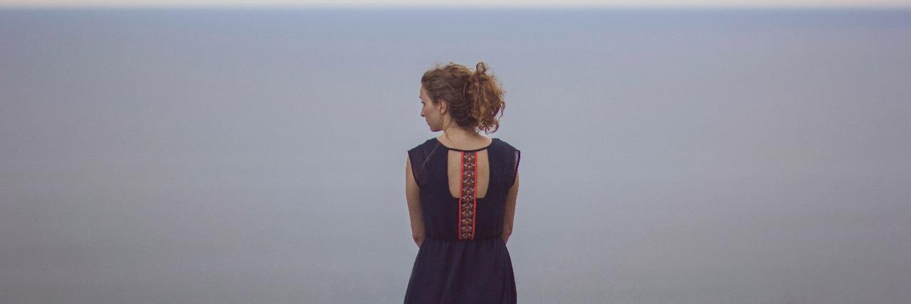 woman staring at the ocean