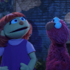 Sesame Street muppets Julia and Elmo singing outdoors at night