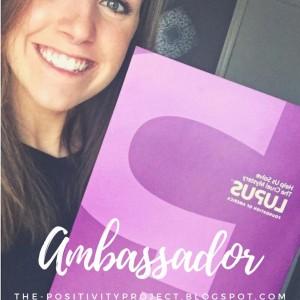 girl holding purple lupus pamphlet