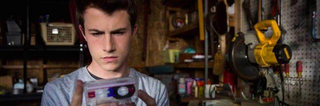 A teenage boy holding a tape