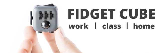 fidget cube resting on person's hands