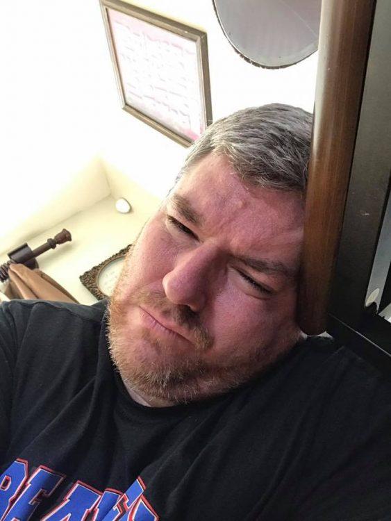 man leaning head down