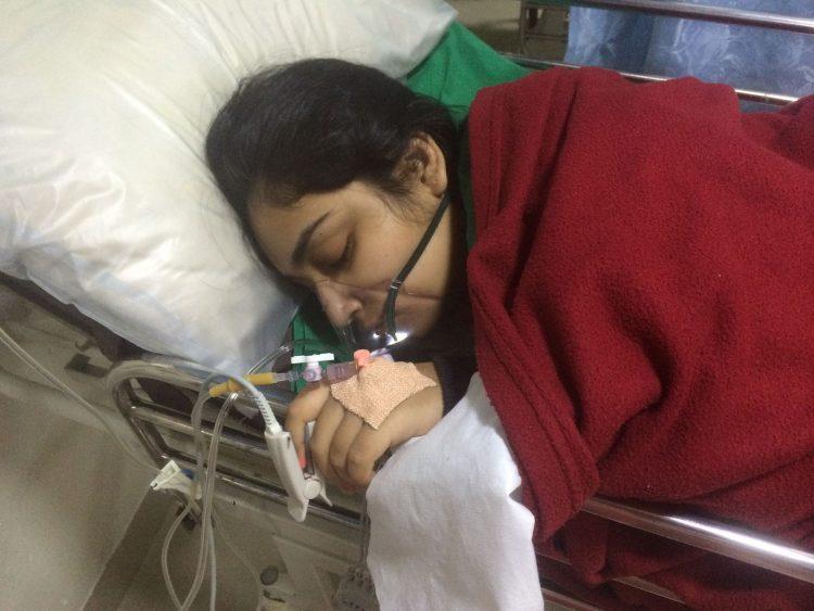 woman sleeping in hospital bed