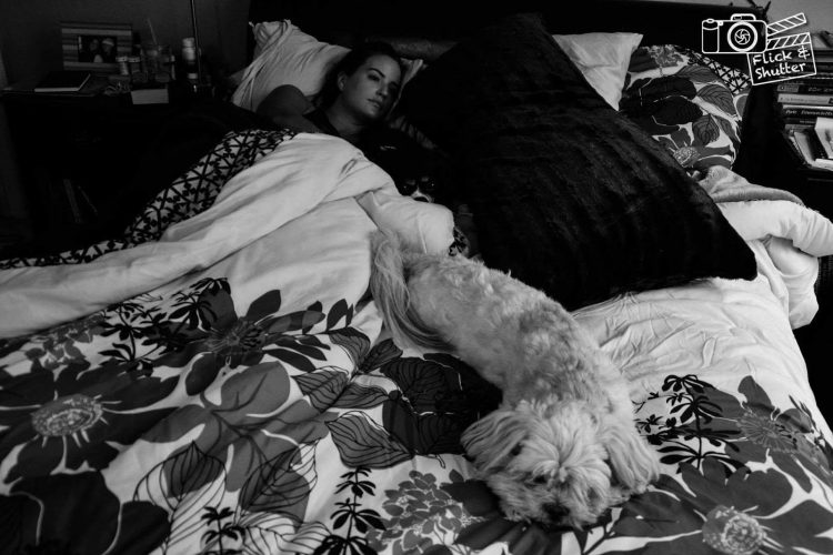 woman in bed with dog