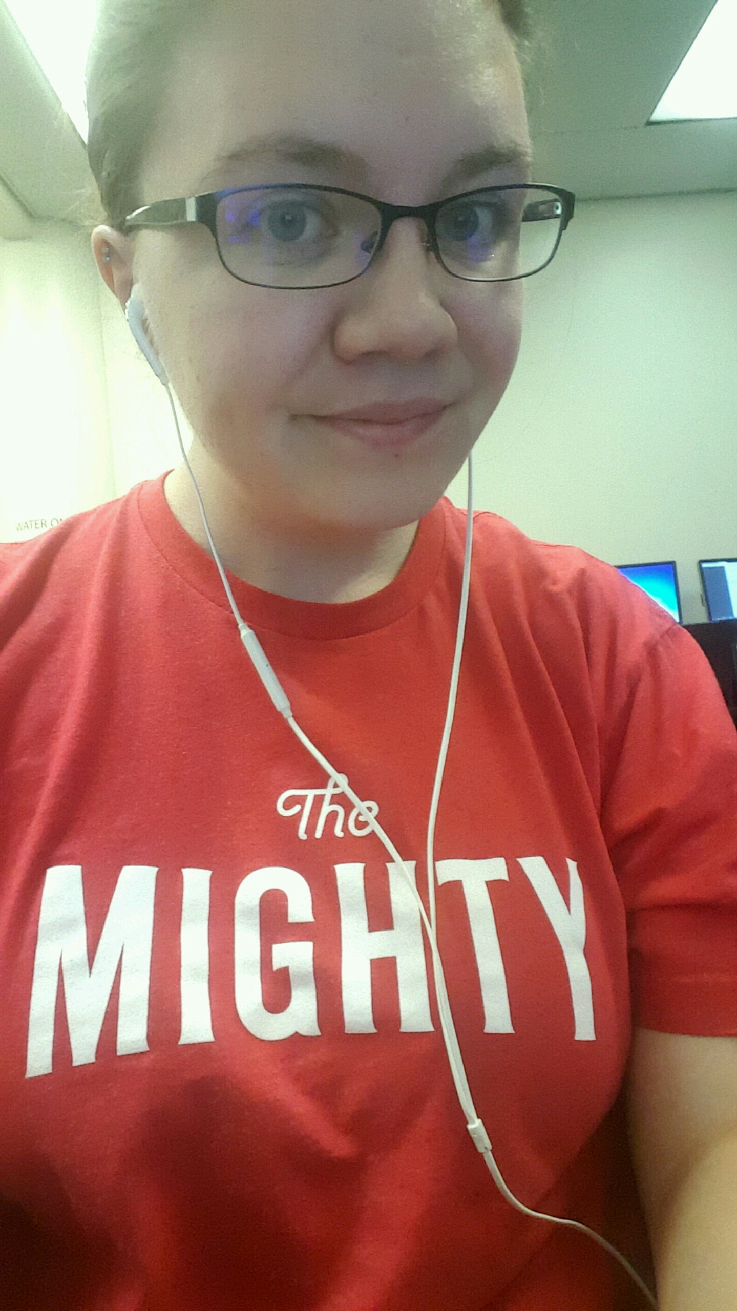 Alaura wearing red t-shirt with The Mighty logo