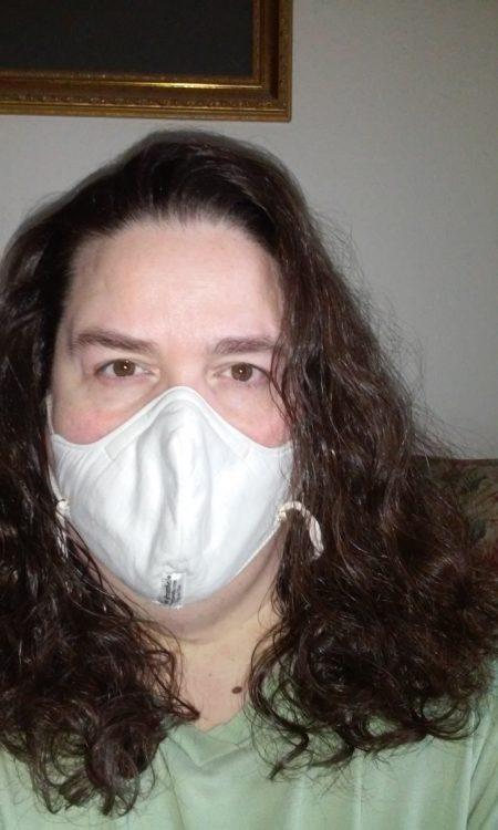 woman wearing white mask.