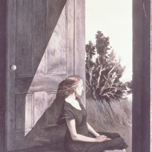 Portrait of a woman leaning against a large wooden door looking into the outdoors