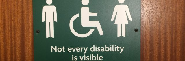 "Bathroom sign saying ""not every disability is visible.'"