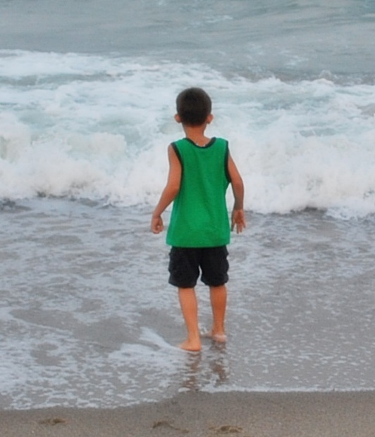 little boy running in ocean