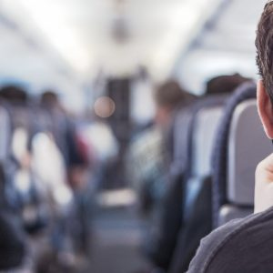 Photo of a man sitting on a plane.