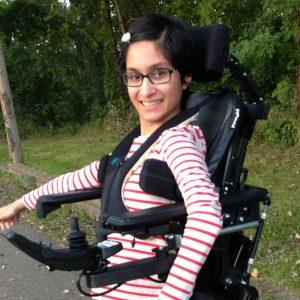 Neha in her standing wheelchair.