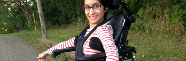 Neha in her standing wheelchair.