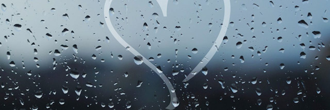 heart drawn on rainy window