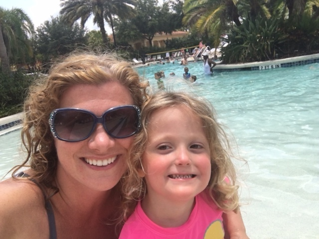 The author and her daughter at a pool