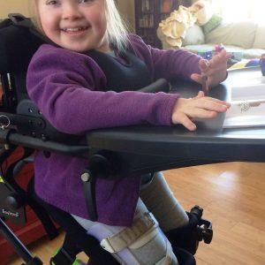 little girl in standing wheelchair